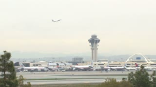Planes Take Off  At LAX