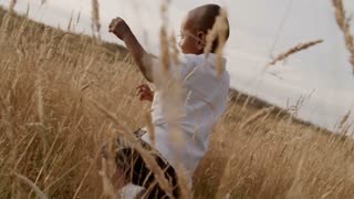 African American child playing in wheat field