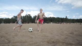 Playing Football Children On Beach