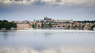 Pleasure boats on the  River Vitava, with the Charles Bridge and St. Vitus Cathedral in the distance, Prague, Czech Republic, Europe - T/Lapse