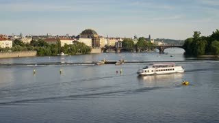 Pleasure boats on the  River Vitava, with the weir and Charles Bridge in the distance, Prague, Czech Republic, Europe, T/Lapse