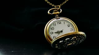 Pocket Watch Time Lapse Graded. Antique looking pocket watch on black surface, shot in time lapse. Graded version. Rendered in UltraHD 4K from high resolution stills.