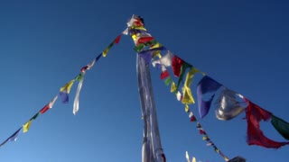 Pole with Buddhist Prayer Flags in Wind