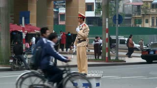 Police Directing Traffic In Vietnam