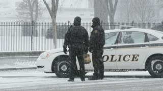 Police Patrolling in Snow
