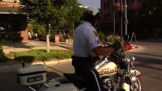 Policeman Drives Away, Lights Flashing