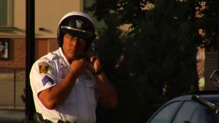 Policeman Putting On Helmet And Gloves