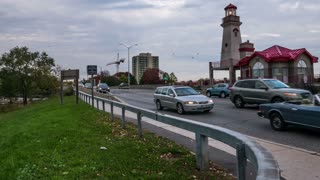Port Credit Lakeshore Lighthouse Time Lapse. Time lapse shot of Lakeshore road and the Port Credit lighthouse, in Port Credit, Mississauga, Ontario, Canada.