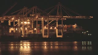 Port of Oakland Cranes Working at Night