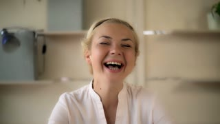 Portrait laughing middle aged woman. Female looking at the camera and laughs. She looks happy and glad. She received good news. Caucasian model with blonde hair