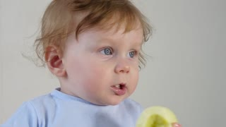 Portrait of a handsome kid tasting apple