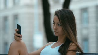 Portrait of a young caucasian teen girl with a modern smartphone. HD cinemagraph - motion photo seamless loop