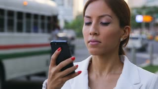 Portrait of businesswoman writing text message with mobile phone