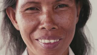 Portrait of real Asian people, with emotions and feelings, looking at camera. Mature woman from Cambodia, Asia smiling