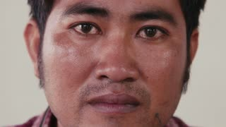 Portrait of real Asian people, with emotions and feelings, looking at camera. Serious adult man from Cambodia, Asia. Closeup of face