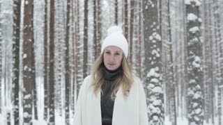 Portrait Of Young Woman In Winter Forest
