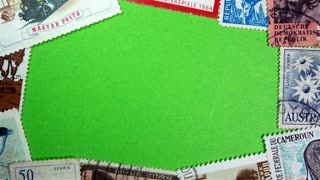 Postage stamps on a green screen