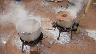 Pots Boiling On Charcoal Fires