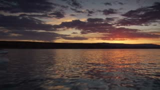 Pov Boating Over Lake With Beautiful Sunset And Speedboat