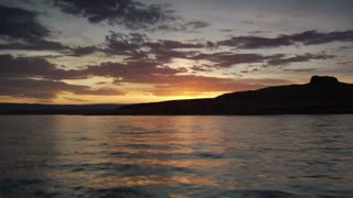Pov Boating Over Lake With Beautiful Sunset