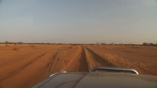 Pov Driving Over Rutted Road In Desert