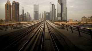 POV Time lapse journey on the modern driverless Dubai elevated Rail Metro System, running alongside the Sheikh Zayed Rd, Dubai, UAE