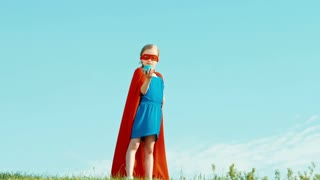 Powerful Superhero Girl Child Protects The World Against The Blue Sky Super Hero Holding In Hands The Planet Earth Zooming