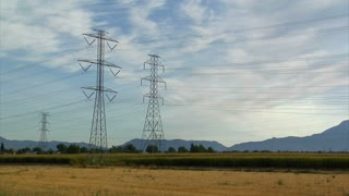 Powerlines And Mountains With Cornfield Timelapse
