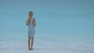 Pretty Blonde Girl Standing Near Ocean