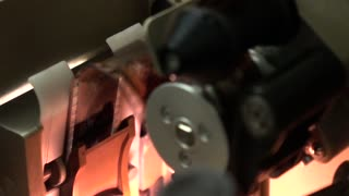 Professional cinema 35 mm film projector in action, slow motion video