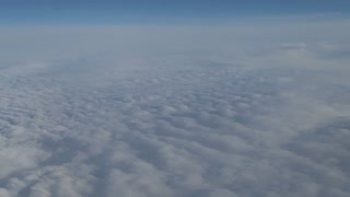 Puffy Clouds From Above 4