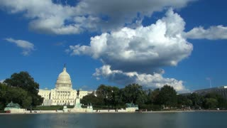 Puffy White Clouds in Sunny Sky Over DC Capitol Building