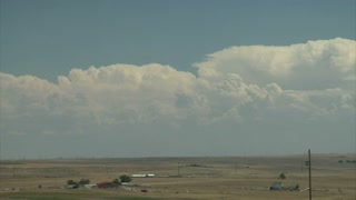 Puffy White Clouds in the Sky Changing Over Vast Plains