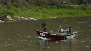 Pullout Shot Of Flyfishing Drift Boat In Calm River