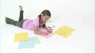 Push In on Eight Year Old Girl Coloring