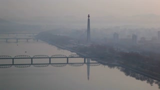 Pyongyang, elevated early morning view of the city and Juche tower across the Taedong river, North Korea, Asia