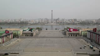 Pyongyang, elevated view across Kim Il Sung Square towards the Tower of the Juche Idea and Taedong river, North Korea, Asia