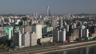 Pyongyang, elevated view of the city from the Yanggakdo International Hotel looking across the Taedong river, North Korea, DPRK, Asia
