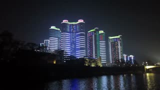 Pyongyang, new modern buildings in the centre of Pyongyang colourfully illuminated at night, North Korea, DPRK, Asia