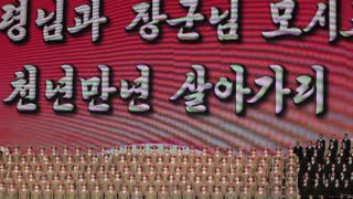 Pyongyang, Propaganda and singing during a concert at the Pyongyang concert hall, North Korea, DPRK, Asia