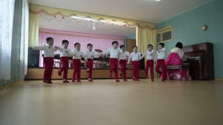 Pyongyang, schoolchildren singing and performing in the Children's Palace, North Korea, Asia