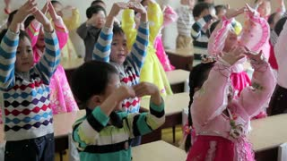 Pyongyang, schoolchildren singing in a classroom, North Korea, Asia