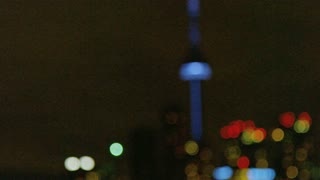Rack Focus of CN Tower and Skyline at Night
