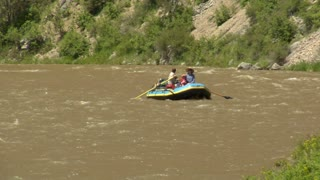 Raft Floats Down River On Small Rapids
