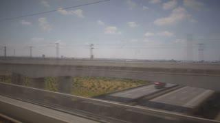 Railways and Highways Shot through Train Window