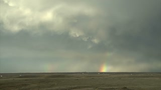 Rainbow Near Storm Clouds