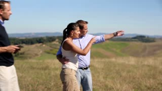 Real estate agent showing the property in the countryside married couple