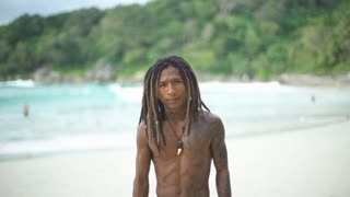 Real guy with strong character and personality. Asian man with dreadlocks hairstyle and tattoos