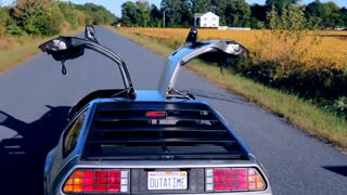 Rear View of Double Open Gull-Wing Doors on Delorean Crane Down Shot