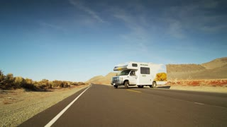 Recreational Vehicle Pulls Out From Desert Stop